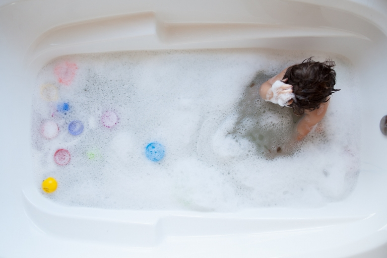 iphone photograph by award winning Edmonton family photographer of toddler in the bath