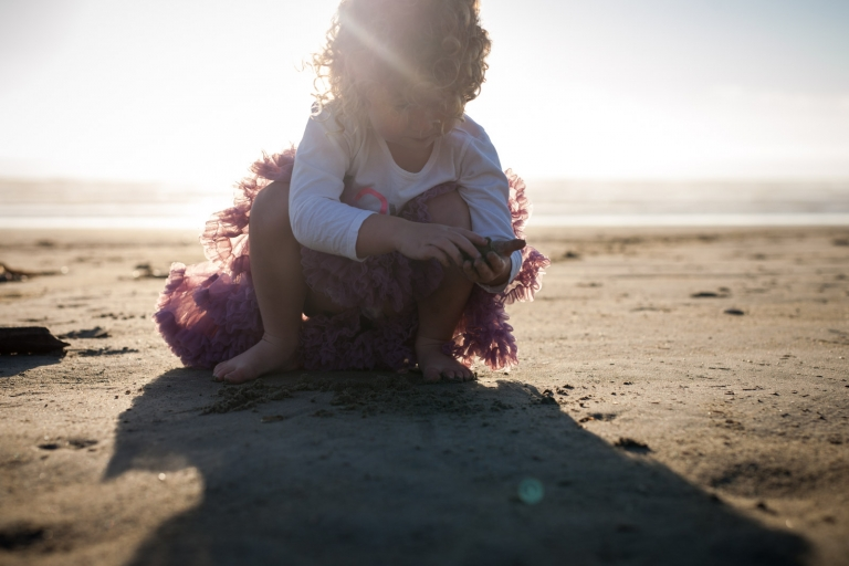 girl exploring on beach captured candidly by Edmonton family photographer
