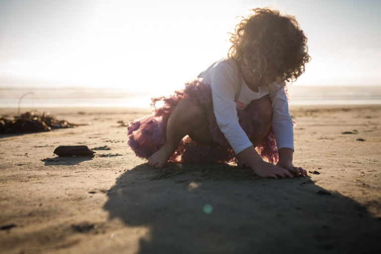 honest photograph of child playing on beach by Edmonton family photographer
