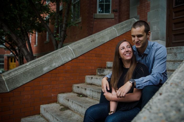 bride to be looks at her future husband during complimentary engagement session