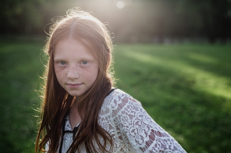 a freckled tween participates in outdoor fall back to school mini sessions for Edmonton kids