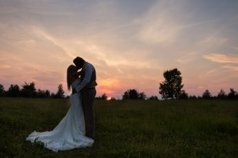 sunset silhouette bridal couple