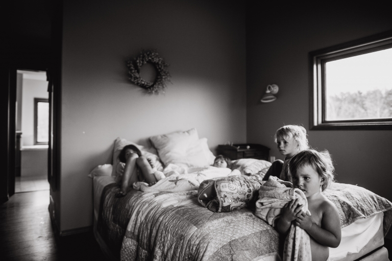 kids hang out in mom and dad's bedroom as mom begins to labour