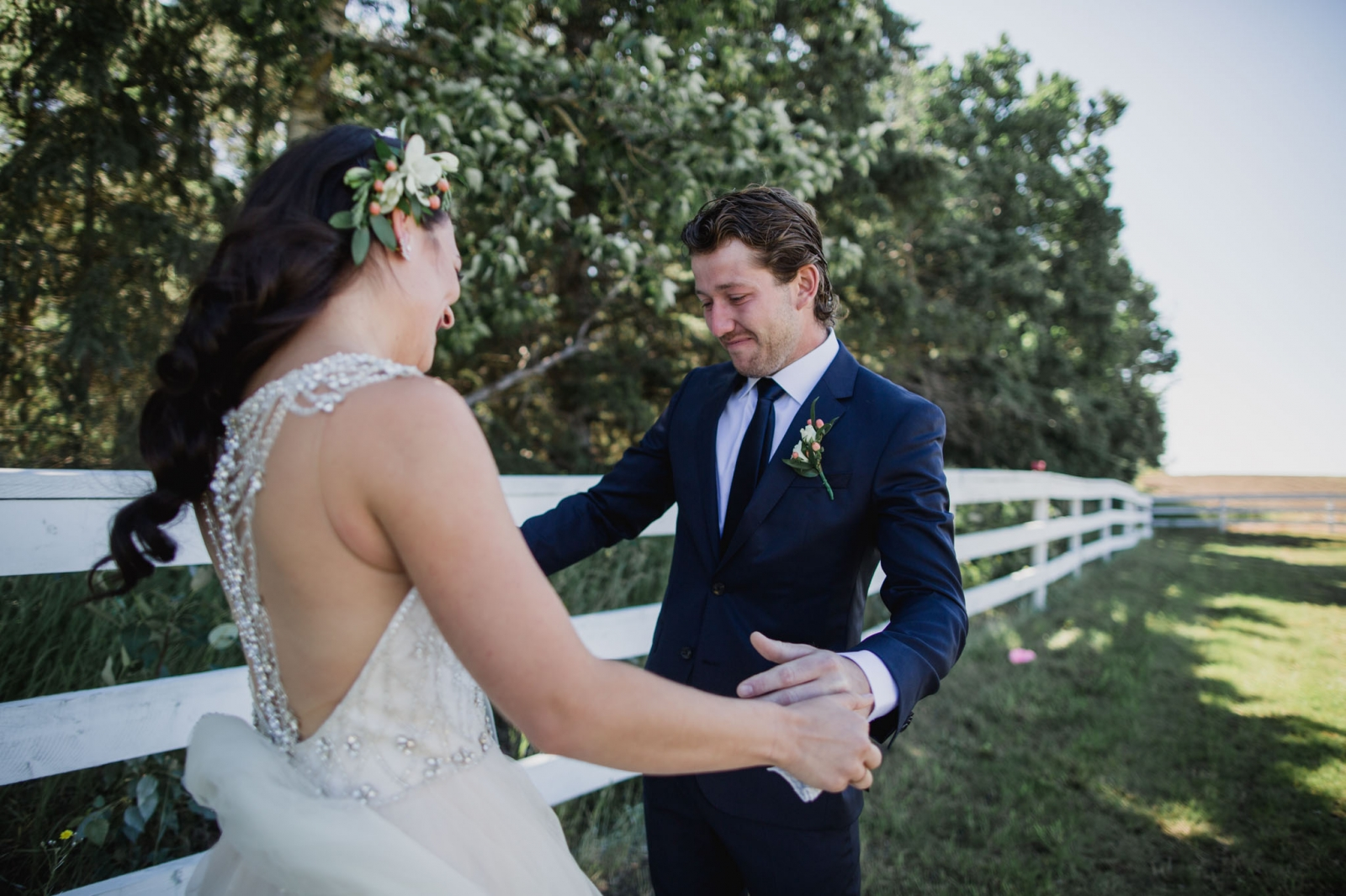 a groom gets emotional when he sees his soon to be wife at their first look