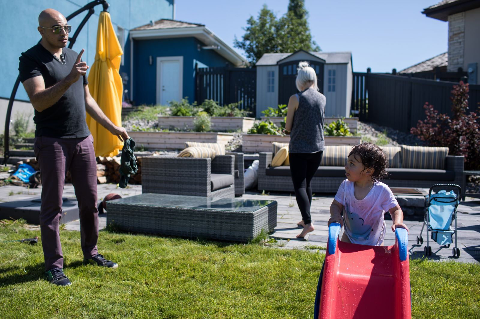 best Edmonton family photographer creates documentary photo of dad parenting his toddler in their backyard