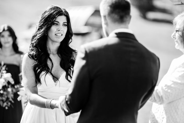 a bride gets teary eyed during her outdoor wedding ceremony at Snow Valley in Edmonton
