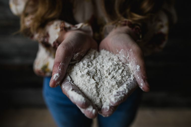 a mother's hands full of flour for conceptual photography project