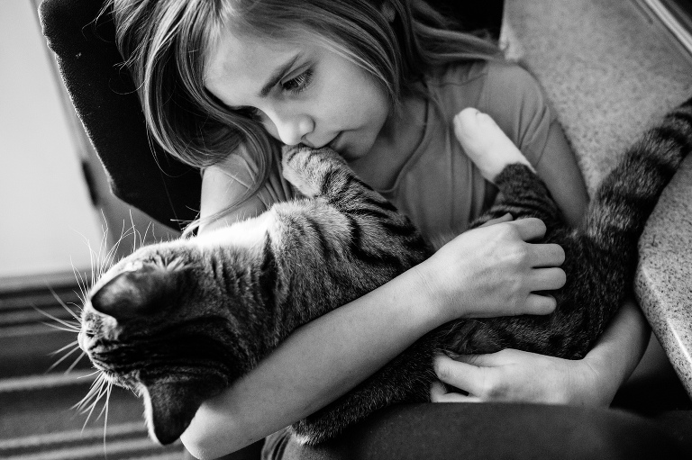 girl cuddling her cat by Hobbs Photography