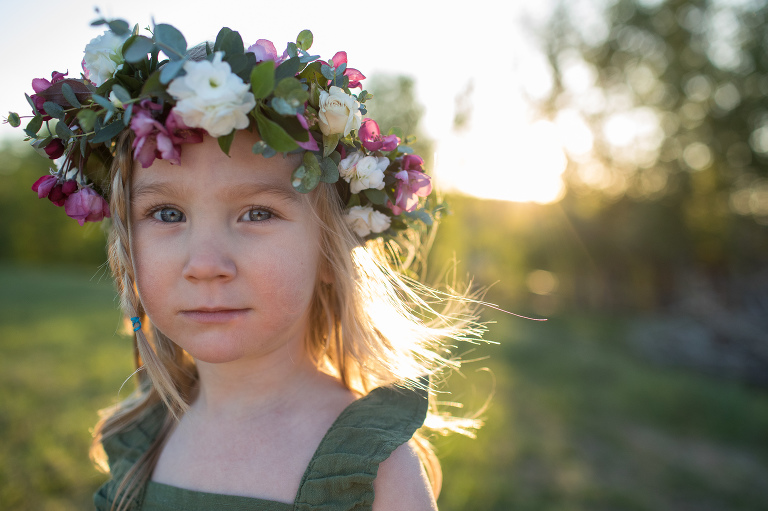 little girl in flower crown outside in summer by Hobbs Photography