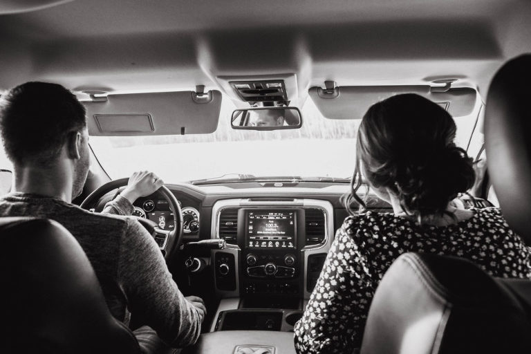 couple drives to outdoor location for engagement photos