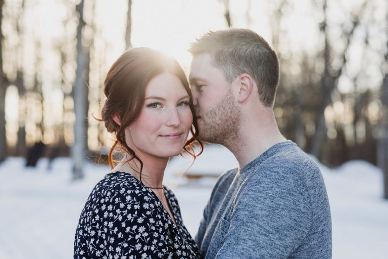 fiance kisses his future bride's cheek during engagement session