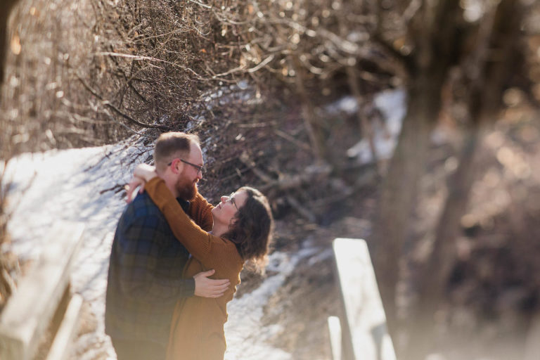 couple laugh together in Edmonton's river valley
