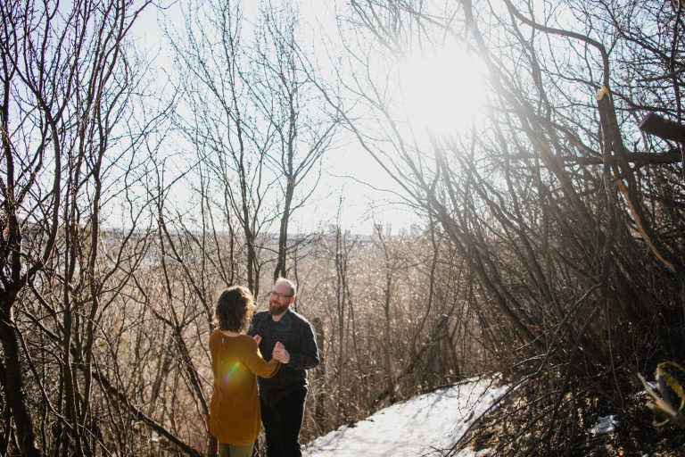 couple cuddle close during morning engagement session