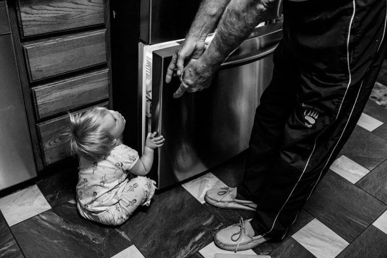 grandpa interrupts toddler opening freezer door