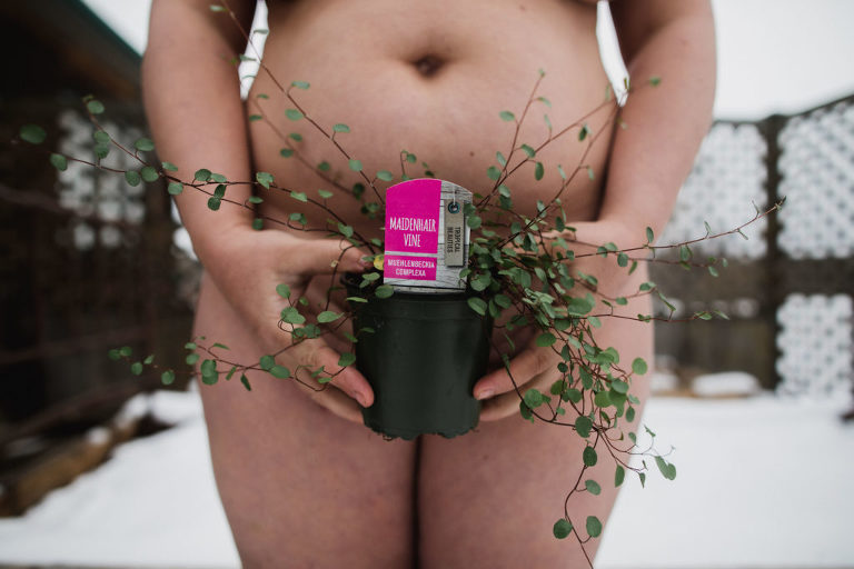 Aimee Hobbs holds Maidenhair Vine plant for World Naked Gardening Day