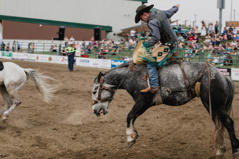 saddle bronc rider at small town rodeo