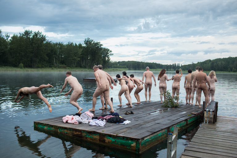 Edmonton area residents jump off the dock nude in event hosted by Edmonton photographers Aimee & Jenna Hobbs