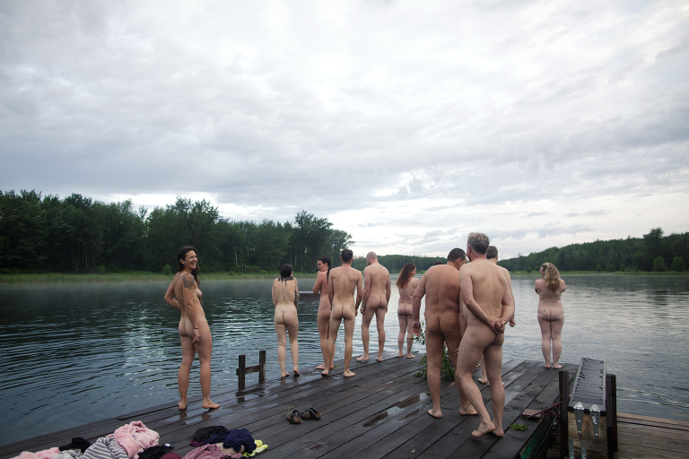 group of Edmontonians gather on dock to celebrate international skinny dip day